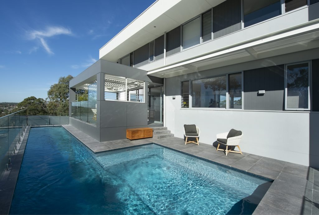 australian home with pool and screens