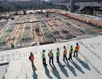 men standing on a construction site